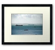 Silhouette of Gig boat racers with large cargo ships in background, St Mawes, Cornwall Framed Print