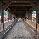 On the Wooden Covered Bridge by Yair Karelic