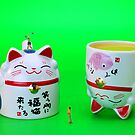 Playing golf on cat cups by Paul Ge