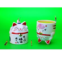 Playing golf on cat cups Photographic Print