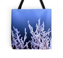 icy twigs and branches in cold snow against blue Tote Bag