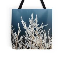 icy twigs and branches in snow against blue Tote Bag