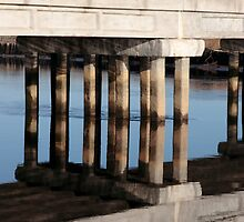 irish road bridge over cold river reflected by morrbyte