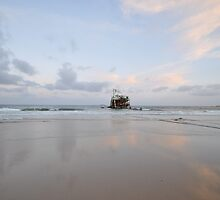 Pretty pink sky over Rusting Hulk in the shallows at Oilies by AngelaHumphries