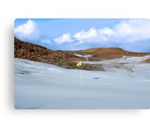 snowfall covered links golf course with yellow flag Canvas Print