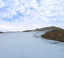 the fairway on a snow covered links golf by morrbyte