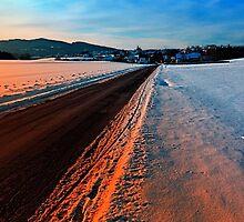 Winter road at sundown by Patrick Jobst