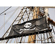 Skull and crossbones pirate flag on tall ship, Plymouth, Devon, UK Photographic Print