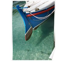 Rudder section of the vintage Looe Lifeboat in azure blue sea, Cornwall, UK Poster