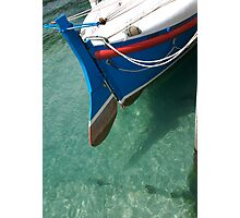Rudder section of the vintage Looe Lifeboat in azure blue sea, Cornwall, UK Photographic Print