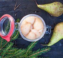 Jar full of pickled pears by Daniel Rönneberg