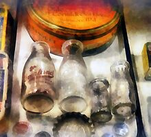Milk Bottles in Dairy Case by Susan Savad
