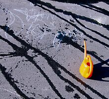 Orange watering can on hot asphalt by kavolis