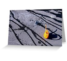 Orange watering can on hot asphalt Greeting Card