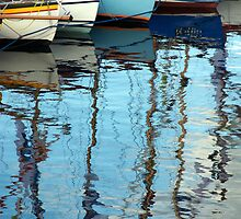 Bows of colourful boats and reflections in harbour, Brest 2008 Maritime Festival, France by silverportpics
