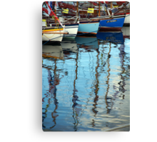 Bows of colourful boats and reflections in harbour, Brest 2008 Maritime Festival, France Canvas Print