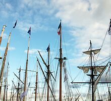 Ships masts with French Tricolore Flag and evening sky, Brest 2008 Maritime Festival, Brittany, France by silverportpics
