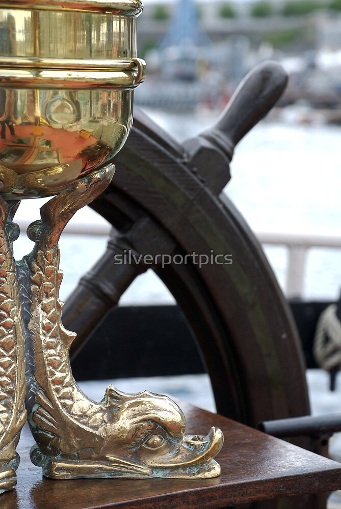 Fish figure and wheel onboard the John William of Hull - a Humber sailing barge, Brest 2008 Maritime Festival, France by silverportpics
