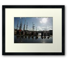 People relaxing on the harbourside with tall ships masts behind, Brest 2008 maritime festival, France Framed Print