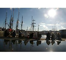 People relaxing on the harbourside with tall ships masts behind, Brest 2008 maritime festival, France Photographic Print