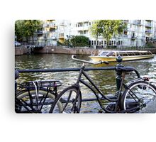 Bike and boat in Amsterdam  Canvas Print