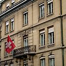 Swiss flag on a Swiss building  by hpostant