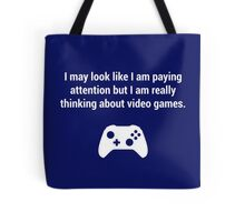 I may look like I am paying attention but really I am thinking about video games. Tote Bag