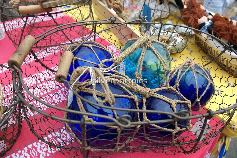 Blue glass fishing floats, Brest 2008 maritime festival, France by silverportpics