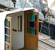 Beautiful coloured glass doors onboard traditional wooden boat, Brest 2008 Maritime Festival, Brittany, France by silverportpics