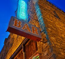 Glowing Oasis - Bar and Neon Signs at Night by Dan Florence