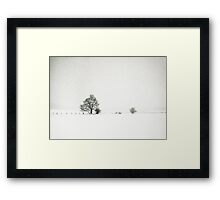 Tree and fence in a snowstorm Framed Print