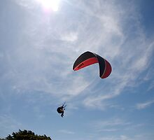 "Parascender, with the word 'Up"" on red and black canopy, in mid flight, Brittany, France by silverportpics"