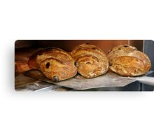 Freshly baked bread in an electric oven  Canvas Print