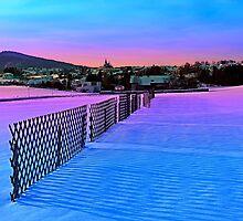 Fences on a winter sundown by Patrick Jobst