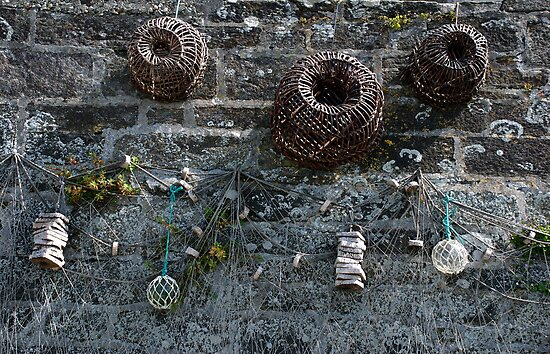 Fishing baskets, glass floats and nets, Brittany, France by silverportpics