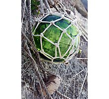 Traditional green glass fishing float and net, Brittany, France Photographic Print