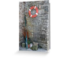 Lifebuoy, boat oar and fishing nets outside house Le Conquet, Brittany, France Greeting Card