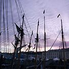 Tall ships in dock with pink sunset, Brest Maritime festival, France by silverportpics