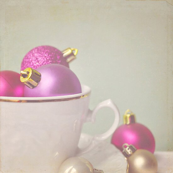 Pink and gold Christmas baubles in china cup by Lyn  Randle