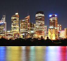 Bright cityscape at night by Albert  Robbins
