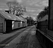 A Street of Thatched Cottages in Snow at Cultra, County Down by Laura Butler