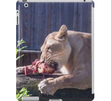 Female lion eating fresh red meat iPad Case/Skin