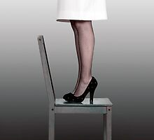 woman on chair by Joana Kruse