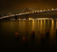 San Francisco Bay Bridge on a Golden Night  by fototaker