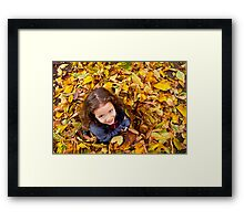 Playing With Autumn Leaves Framed Print