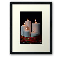 White candles with red ribbon and stars Framed Print