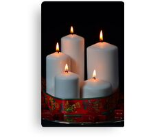 White candles with red ribbon and stars Canvas Print