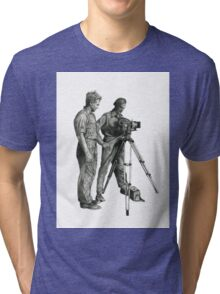 Travel and adventure with a camera. Tri-blend T-Shirt