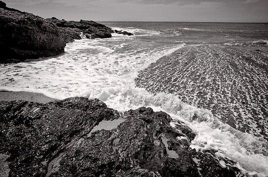 Surge the rocks - Korora - NSW - Australia by Norman Repacholi
