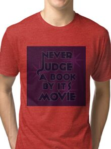 Never Judge A Book By Its Movie (Blue on Purple) Tri-blend T-Shirt